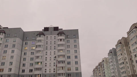 Concrete high-rise buildings in cloudy weather Live Action
