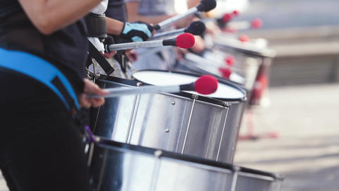 Closeup 4k video of group of street musicians playing on drums. Culture festival Live Action
