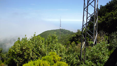 4k footage of high radio or television towers on high mountain peaks overgrown Live Action