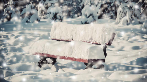 Small bench snow covered with a large thick layer of snow on sunny winter day Live Action