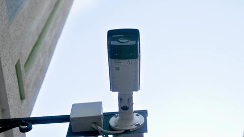 4k closeup video of surveillance video camera monitoring safety on city street Live Action
