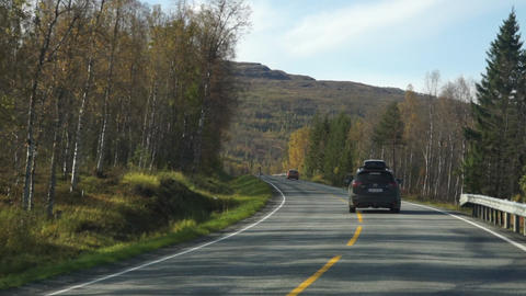 Car follow shot on a beautiful Northern Norway road in autumn Live Action
