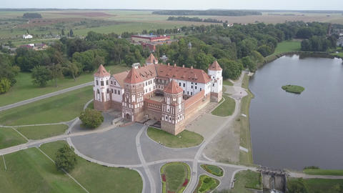 Aerial shot of the famous Mir castle in sunny weather, located in the old Live Action