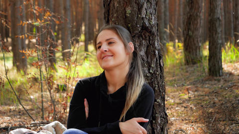4k video of beautiful smiling woman relaxing while sitting on ground at the Live Action