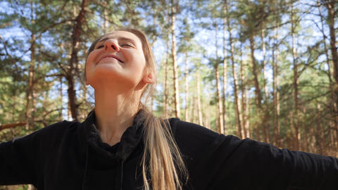 4k video of beautiful smiling young owman smiling and enjoying sunny day and Live Action