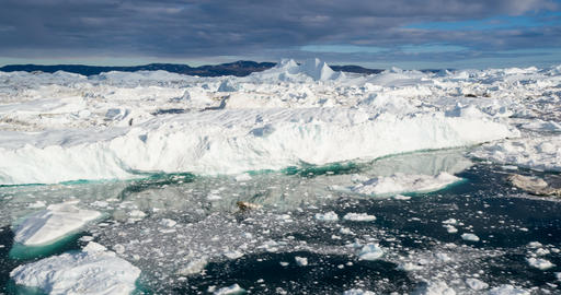 Iceberg aerial footage - giant icebergs in Disko Bay on greenland Live Action
