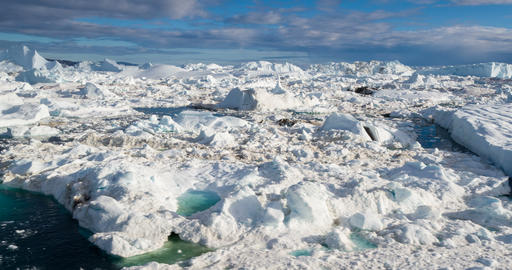 Global Warming and Climate Change - Icebergs from melting glacier in icefjord Live Action