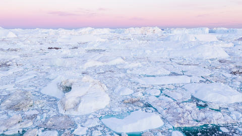 Iceberg from glacier in arctic nature landscape on Greenland - aerial video Live Action