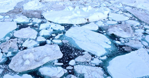 Climate Change and Global Warming - Icebergs from melting glacier in icefjord Live Action
