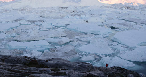 Travel wanderlust in arctic landscape nature with icebergs - Greenland tourist Live Action
