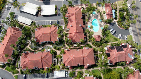 Aerial view of typical Southern California Spanish style residential condo with Live Action