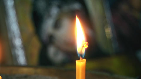 Candle is burning and the icon of the goddess with jesus Live Action