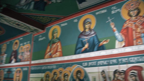 Icons of saints on the wall and the Prayer Altar in the Orthodox Church Live Action
