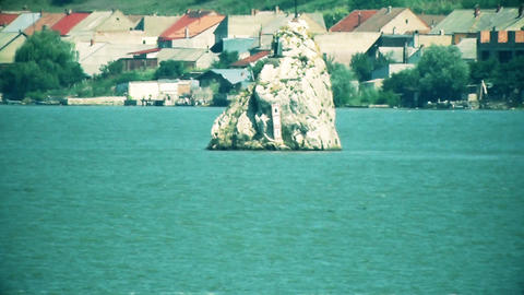 Rock in the middle of the river Danube Live Action