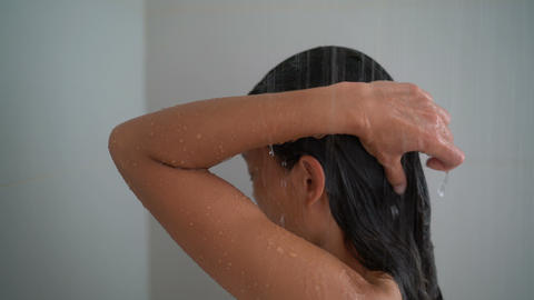 Woman relaxing showering in hotel spa shower or home bathroom Live Action