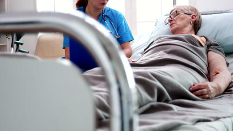 Female nurse taking notes on clipboard in nursing home Live Action