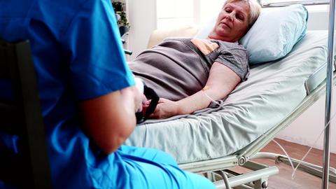 Female nurse helping old woman nursing home Live Action