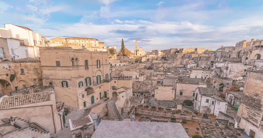 panoramic view of typical stones Sassi di Matera and church of Matera under blue sky. Basilicata, Live Action