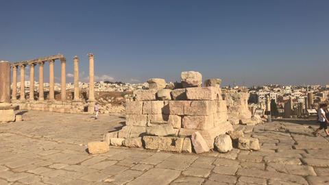 Jerash, Jordan - October 15, 2019: tourists walk on stone roads Live Action