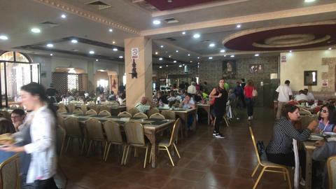 Jerash, Jordan - October 15, 2019: tourists in the restaurant part 1 Live Action