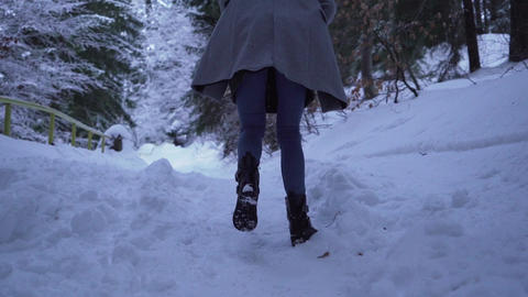 Low angle view of girl in jeans walking in deep puffy snow ライブ動画