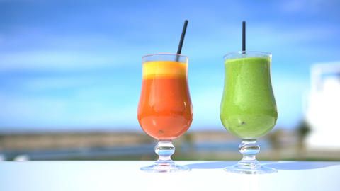 Cold pressed organic juices detox. Green vegetable spinach smoothie fruit drinks Live Action
