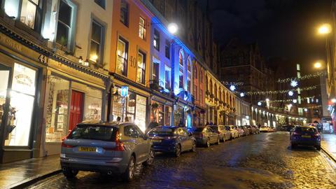 Beautiful Edinburgh by night - street view in old town - EDINBURGH, SCOTLAND - Live Action