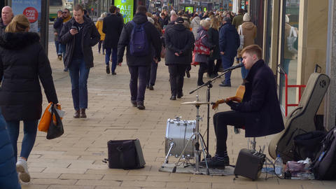 Street musician at Princes Street Edinburgh - EDINBURGH, SCOTLAND - JANUARY 10 Live Action