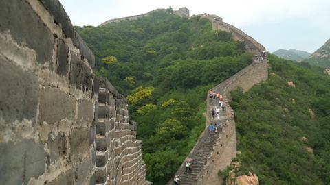 China travel tourist having fun waving hello at the Great Wall in Badaling Live Action