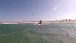 The kite surfer rides the waves of the Atlantic Ocean Live Action