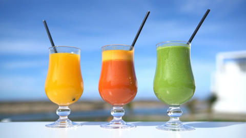 Healthy eating juicing concept - fruit and vegetable juice glasses Live Action