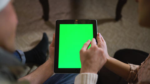 Couple look at green screen ipad on christmas eve Live Action