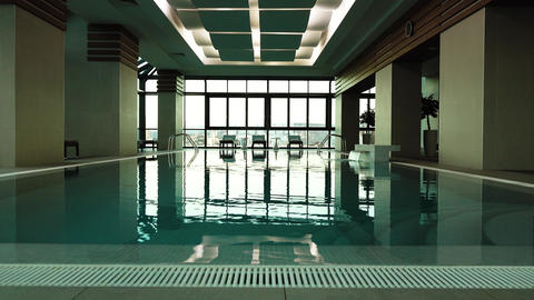 Empty swimming pool indoor of luxury hotel Live Action