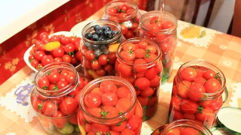 tomatoes in jars prepared for preservation Footage