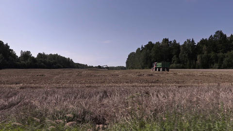 Tractors on cereal field Footage