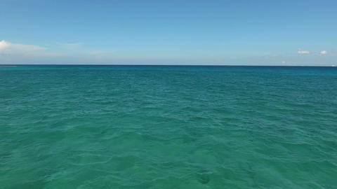 flying drone shot over an beautiful turquoise ocean surface Footage