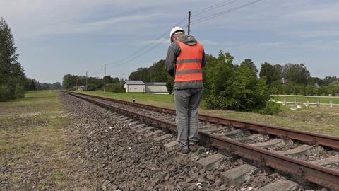 Railroad worker walking near railway Footage