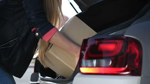 Human hands unloading cardboard boxes from car ライブ動画