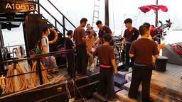 Passengers getting off Junk boat Hong Kong Footage