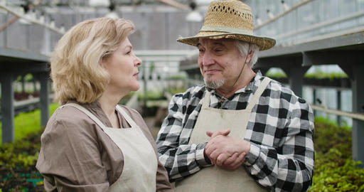 Close-up portrait of positive mature Caucasian man in straw hat and blond woman Live Action