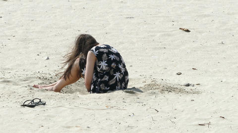 Anon Girl playing in sand Live Action