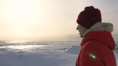 A young man walks along the coast of the Pacific ocean in winter 003 Live Action