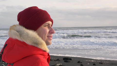A young man walks along the coast of the Pacific ocean in winter 008 Live Action