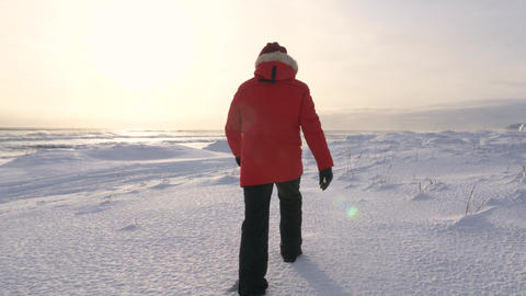 A young man walks along the coast of the Pacific ocean in winter 005 Live Action