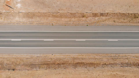 Top view drone shot above narrow desert road Live影片