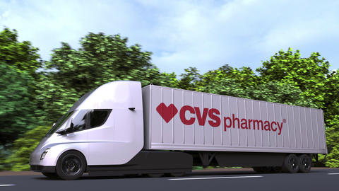 Electric semi-trailer truck with CVS PHARMACY logo on the side. Editorial GIF