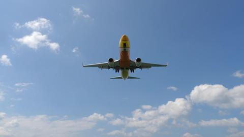 NOK Air Boeing 737 approaching over ocean GIF