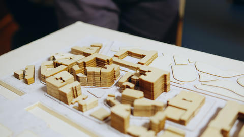 Close up of architect hand checking city model concept GIF
