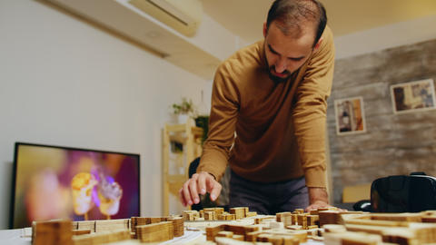 Creative architect in his home office working on a big project Live Action