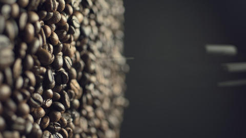 Closeup of coffee beans fall down in slow motion Live Action
